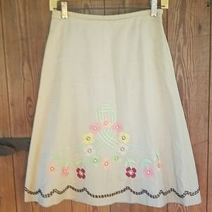 Tan skirt with soft colored designs